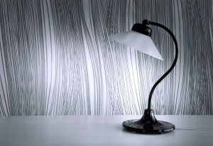 Desk lamp against waved background.